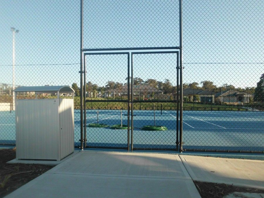 This example is 3.6m high black on black chainwire tennis court with ...