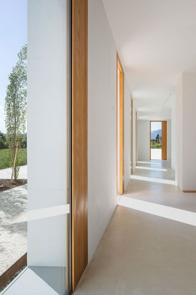 White interior with wooden accents by Baumschlager Eberle.
