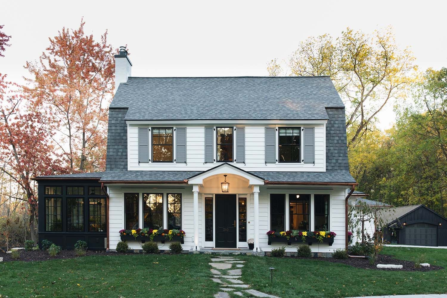 Delightful Modern Farmhouse Style Home Nestled In East Grand Rapids Farmhouse Style House Dutch Colonial Homes Dutch Colonial Exterior