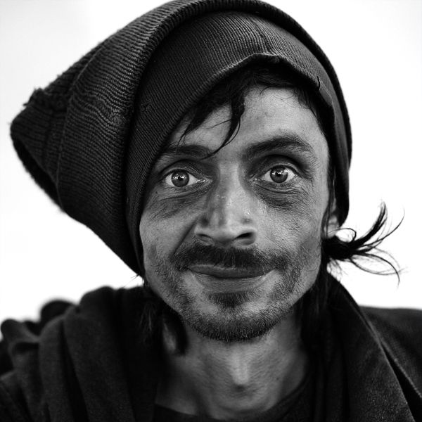 Homeless/4 by Igor Mokhovyk - Homeless man. The man who smile. Street portrait.
