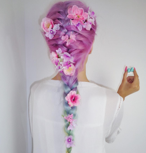 Long braid hairstyle with flowers by Amythemermaidx