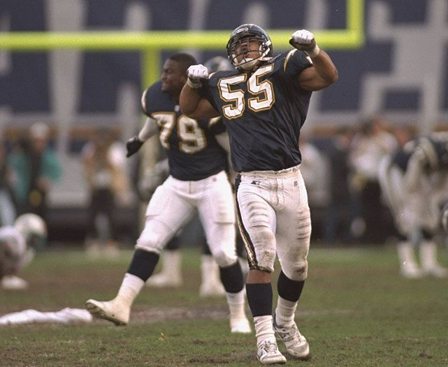 Junior Seau celebrates after a 1995 playoff victory over the Dolphins. Seau reportedly died on Wednesday from a self-inflicted gunshot wound. (Richard Mackson/SI)
