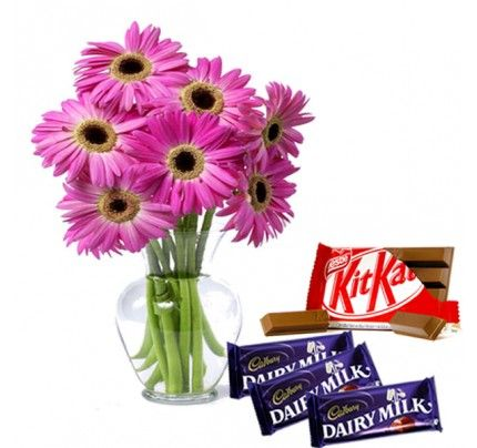 A vase of Pink Gerberas with a KitKat and the Cadbury Dairy Milk ...