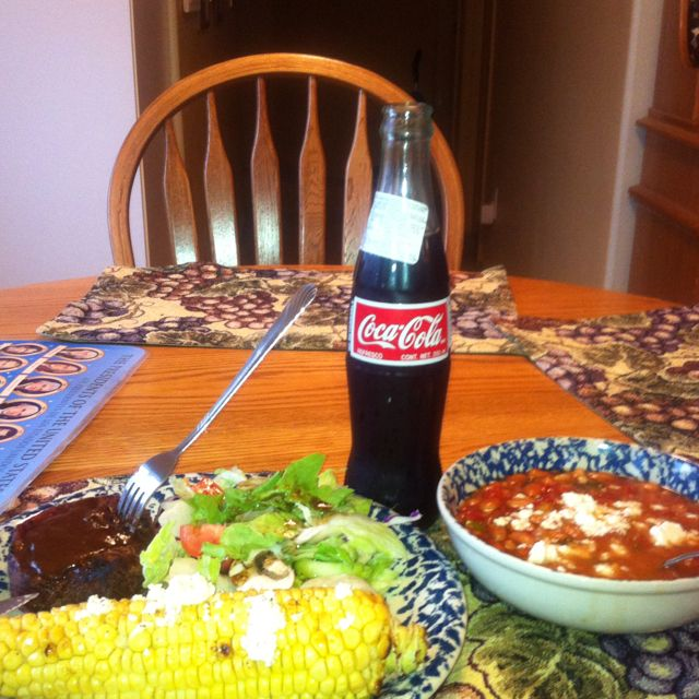 Steak,corn on the cob with Mexican white cheese & frijoles home made with a Mexican Coke good meal we are haveing.