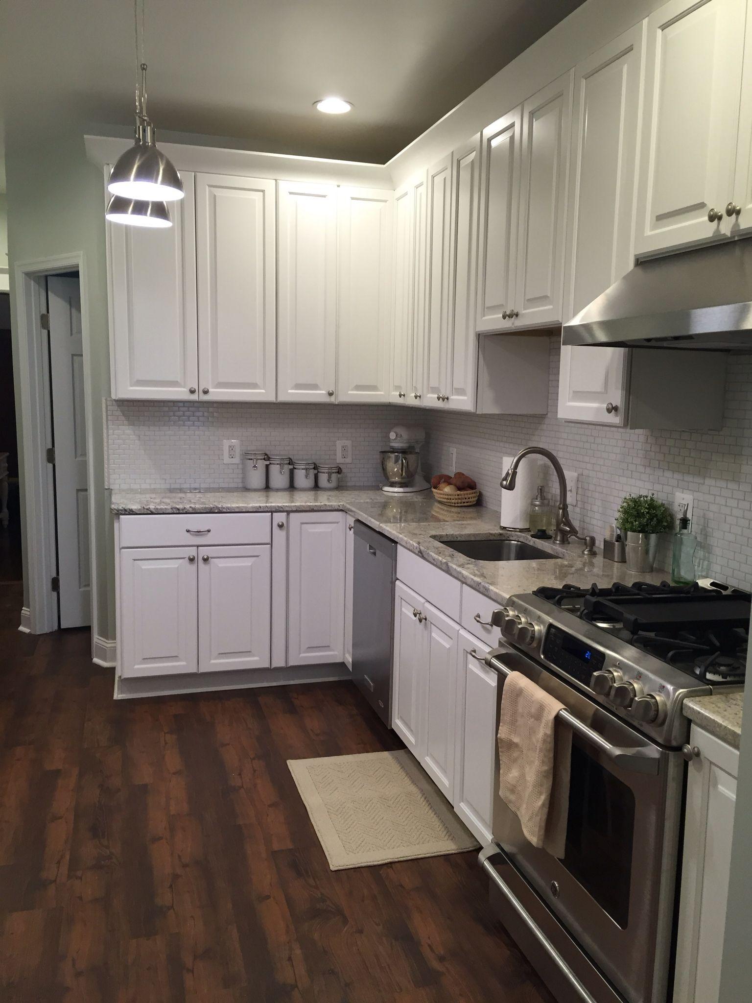 American Woodmark cabinets GE Cafe range resilient flooring in