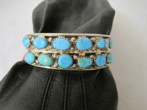 Sterling and turquoise cuff bracelet   can be by MyRedFlamingo, $49.99