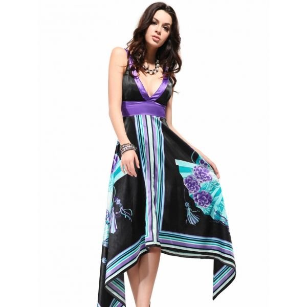 An asymmetrical hi-lo blue and purple and black DRESS with ample cleavage.