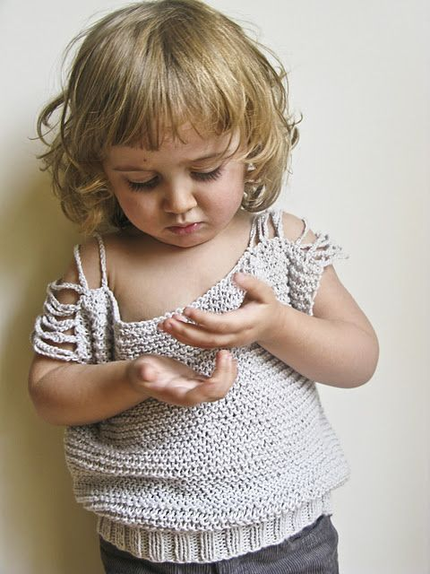 Casual sleeveless jumper: Two squares of garter stitch with simple crochet chains for shoulder detail.
