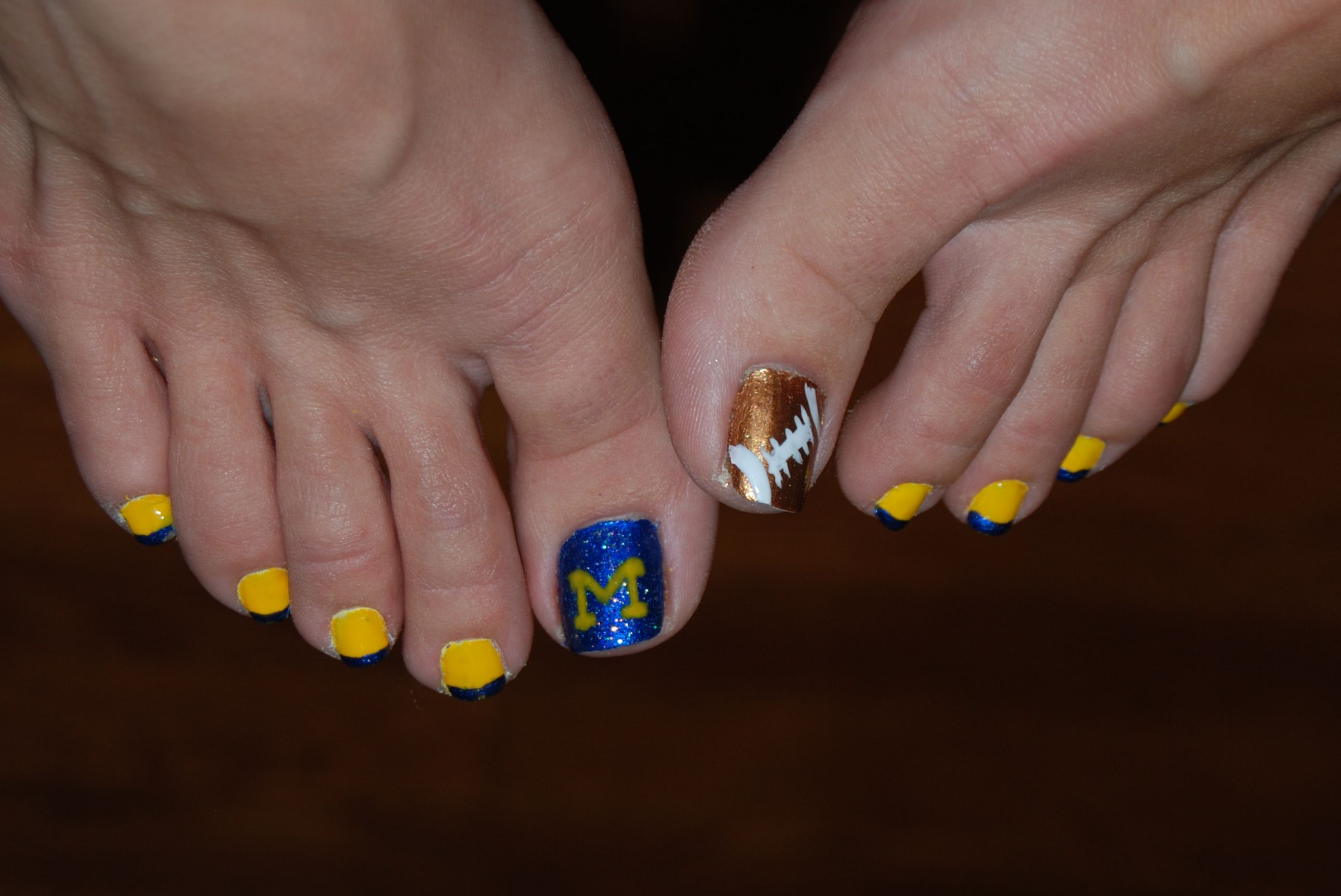 Michigan football nail art-hand painted. I wish it wasn\'t pictured ...