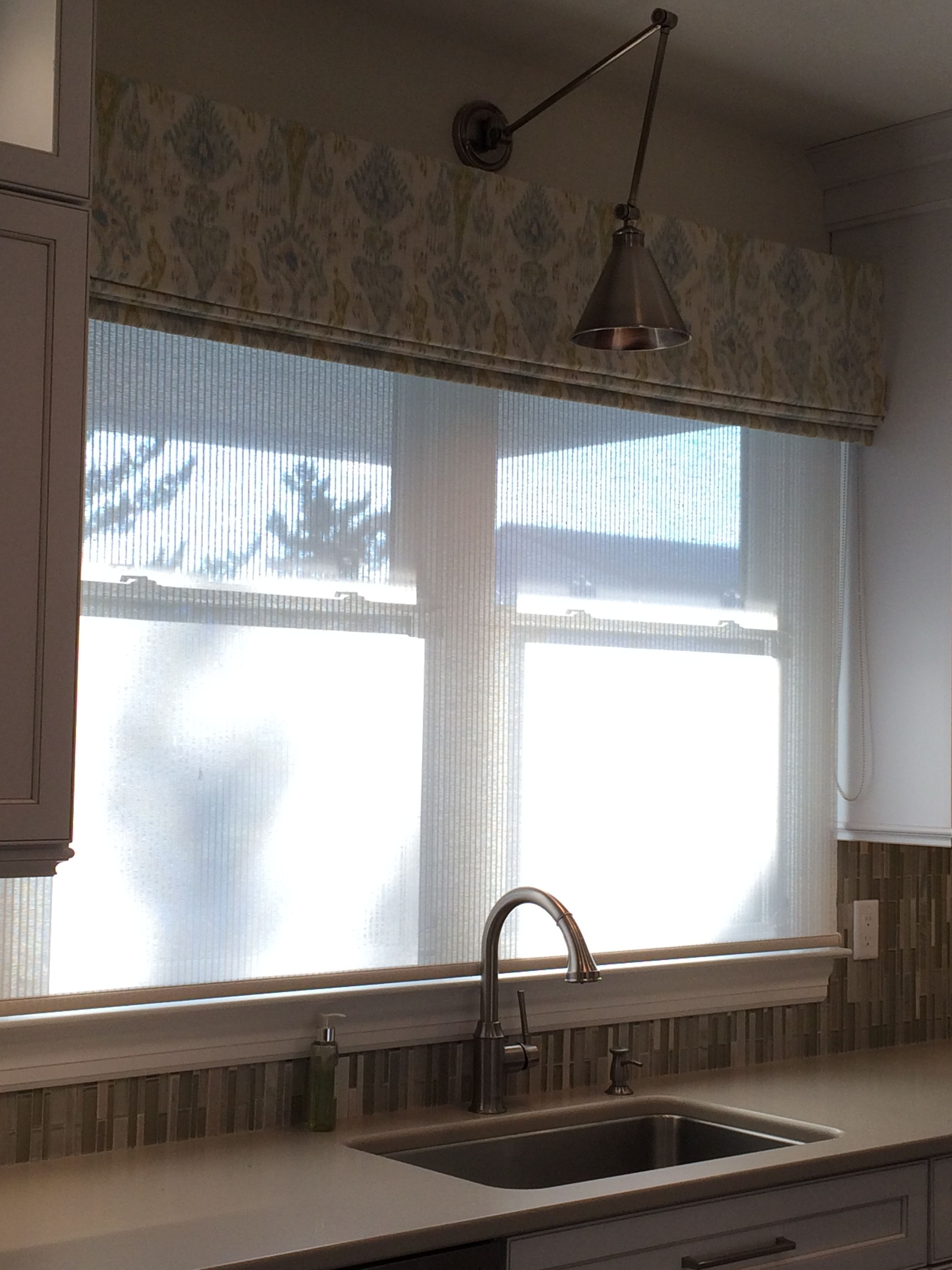 Ikat fabric valance over translucent woven shade on for Fabric shades for kitchen windows