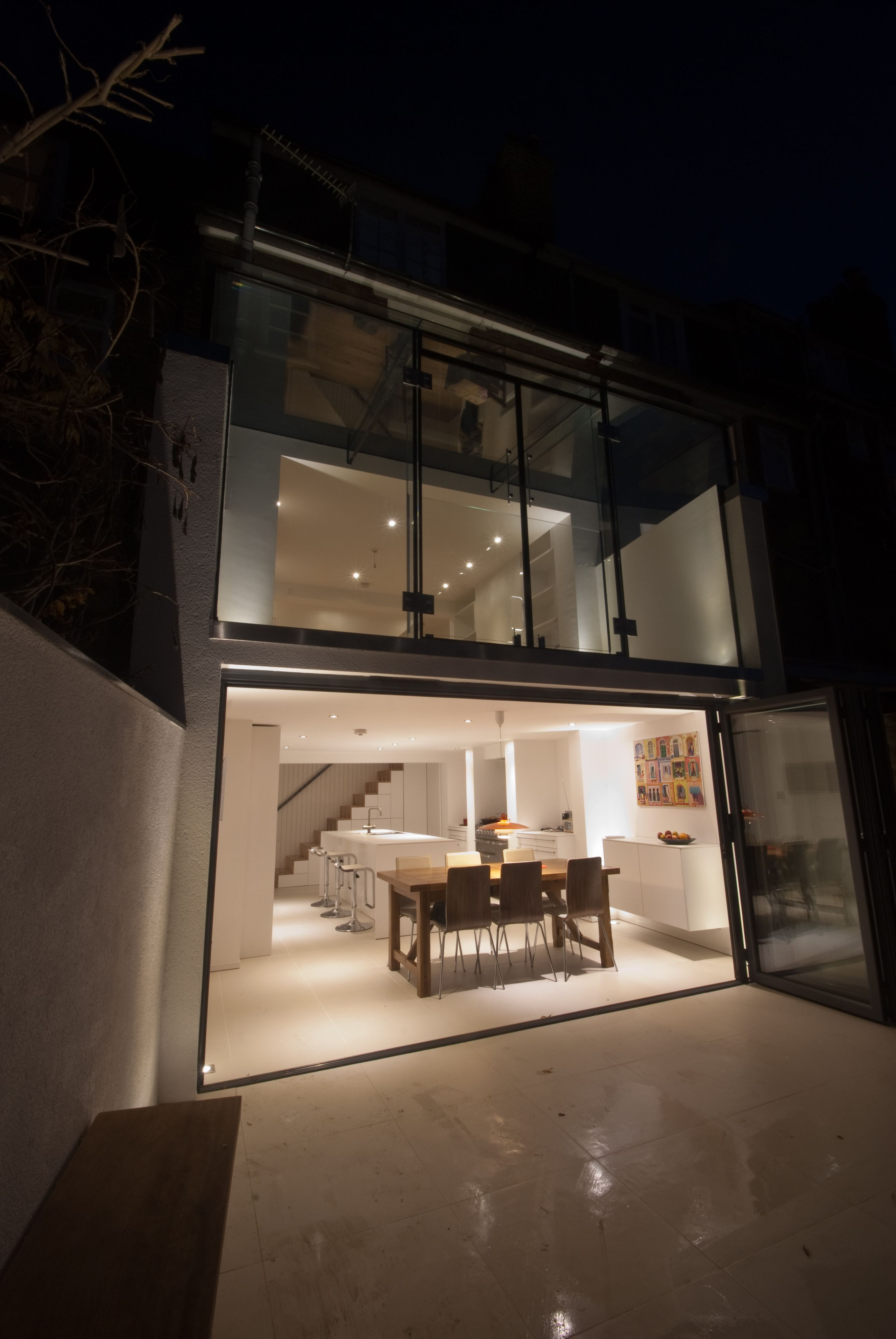 A contemporary glass extension to a four storey terraced house in
