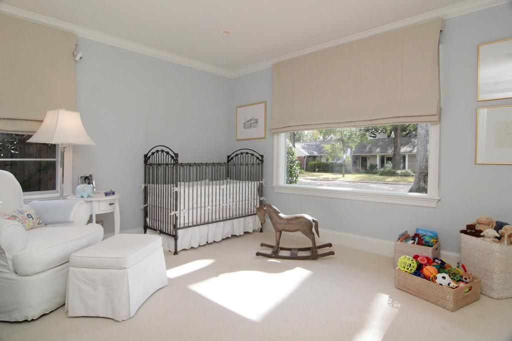Secondary bedroom 13X11 features neutral carpet and
