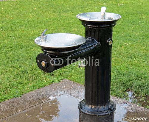 Old-fashioned water fountain in the park.