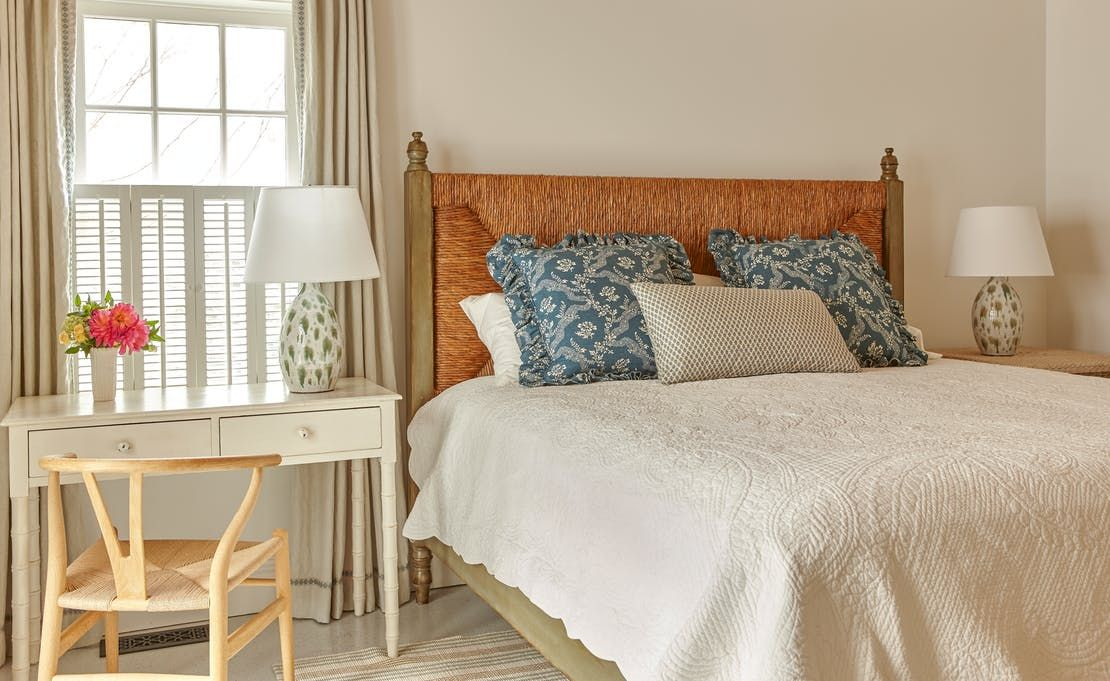 Guest Bedroom in beach house cottage with rush headboard