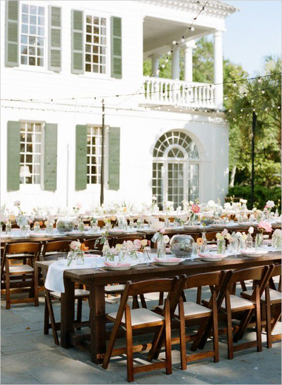 Outdoor wedding reception with family style seating. Venue: Lowndes Grove Plantation --- http://www.weddingchicks.com/2014/05/28/get-married-in-charleston/