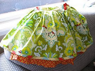 need to make this style skirt for Olivia and emma for emma's birthday... also need to make coordinating doll outfit too.... what do you think @Tifani Jefferis.... this style but different fabrics for each of my girls. I may use fabrics I already own and put a simple long sleeve t shirt with it... and tights and flats.