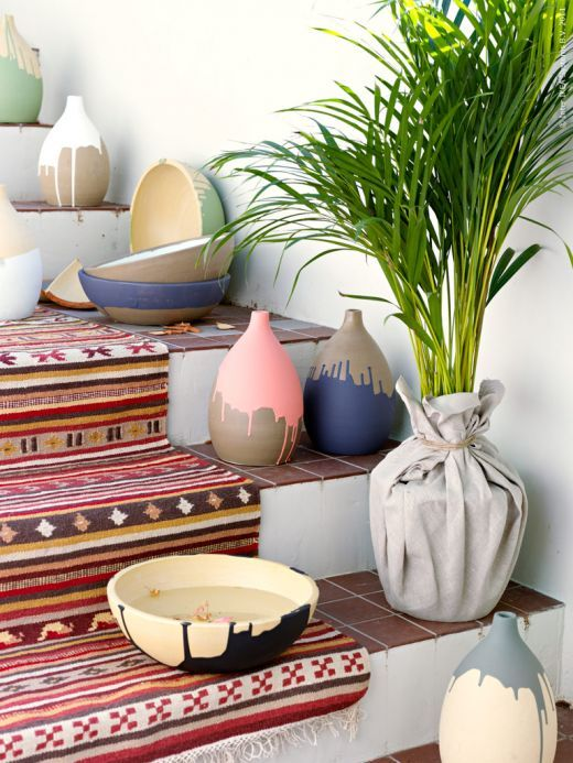 Moroccan inspired paint drip vases. Not concrete, but you could make them concrete.