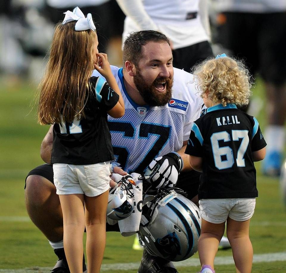 Carolina Panthers center Ryan Kalil center greets his daughters