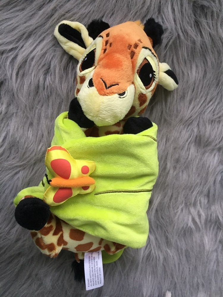 This soft and cuddly baby Giraffe comes with its original ...