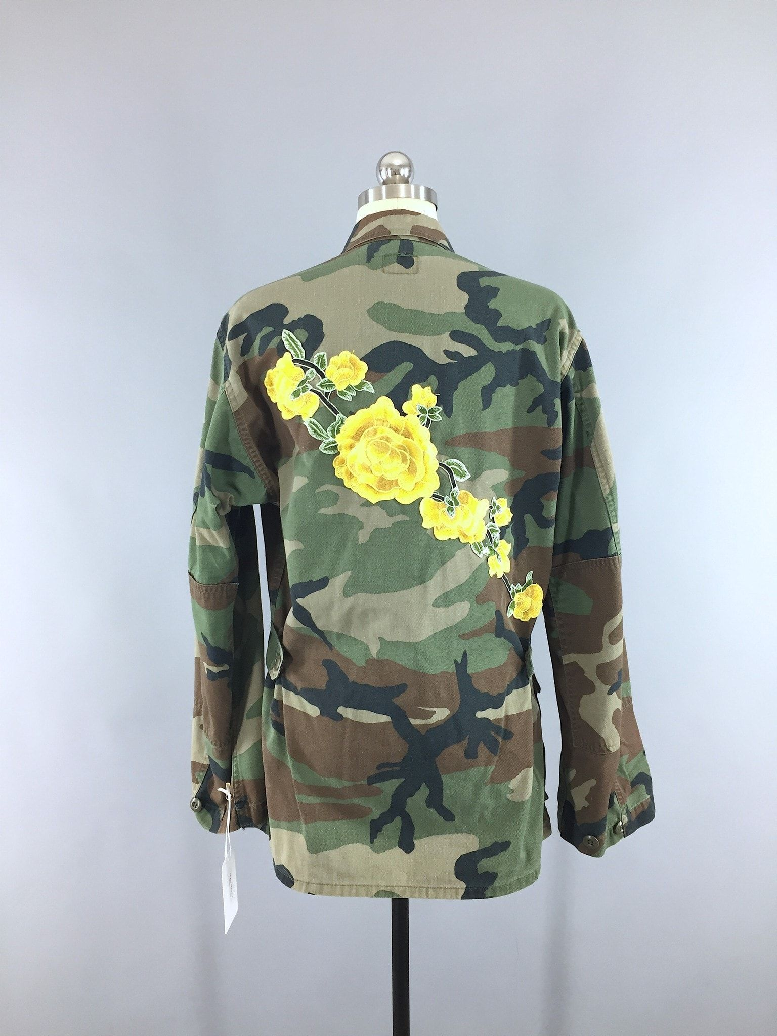 30ec20636fdb6 Awesome and completely one-of-a-kind, this vintage US Army jacket has been  enhanced with a large yellow floral embroidery patch. The floral embroidery  is ...