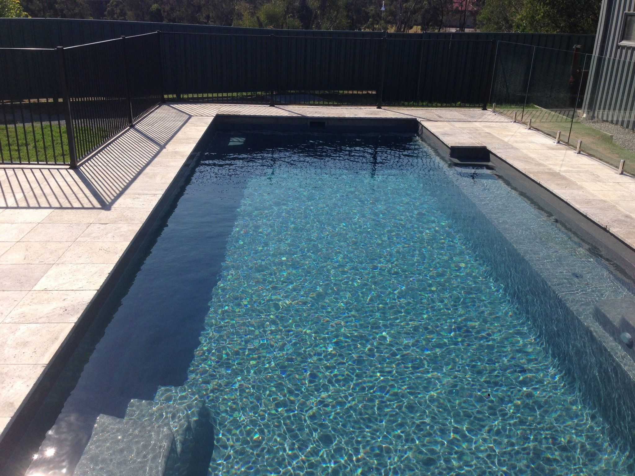 A Compass Pools 9 4 Vogue In Viridian From The Bi Luminite Range Of Colours Pool Landscape Design Travertine Pool Decking Swimming Pool Landscaping