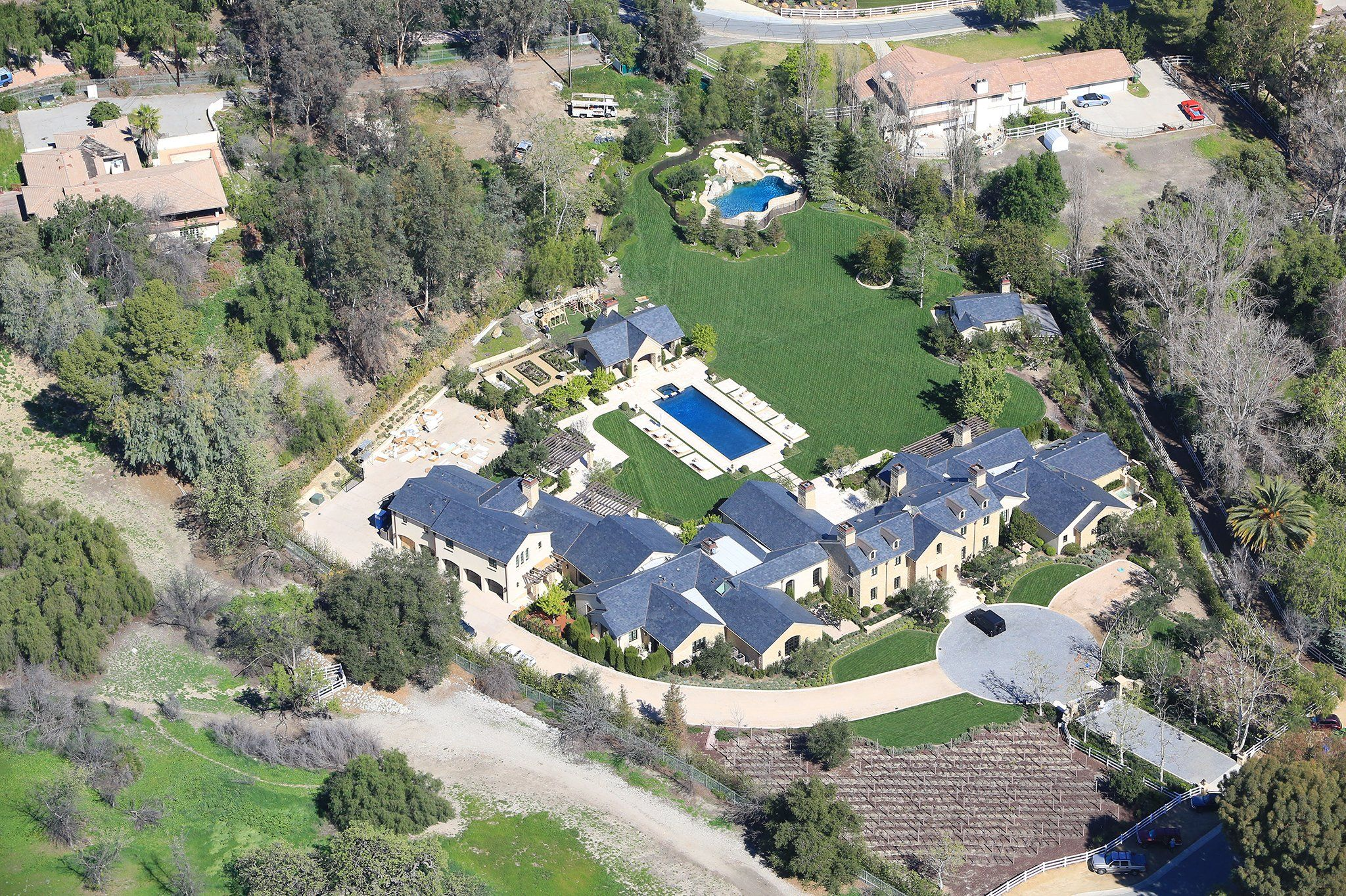Kim Kardashian And Kanye West S Epic Backyard From A Playground For North To A Pair Of Pools Kim And Kanye House Celebrity Houses Home Pictures