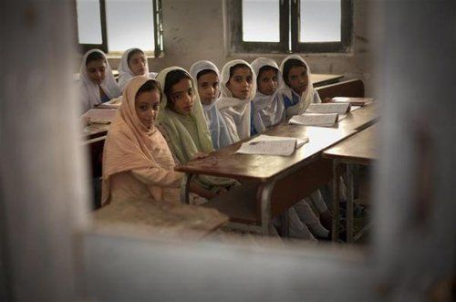 Pakistan, 2009: Girls attend the first day of class in Swat District, North-West Frontier; the school had been closed due to armed conflict in the area.