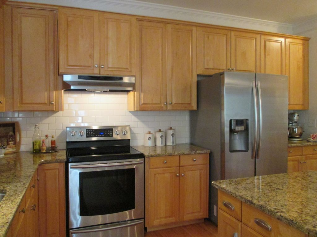 - Traditional Kitchen With Complex Granite Counters & Subway Tile In