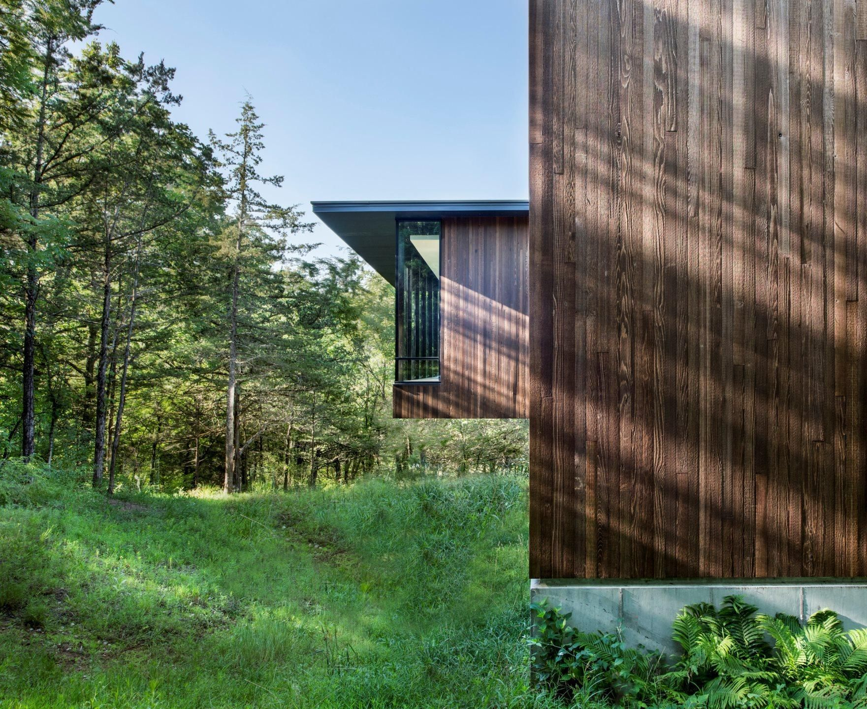 Weathered wood rainscreen system blends into the environment - BNIM #modernhouses #modernrustic #exteriordesign #archdaily #bestarchitecture