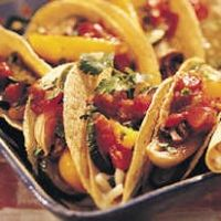 Roasted Vegetable Tacos.  Easy recipe...the children really like it too.  Instead of salsa I dice fresh tomatoes and add sliced avocado.  As always, I forgo the cilantro.