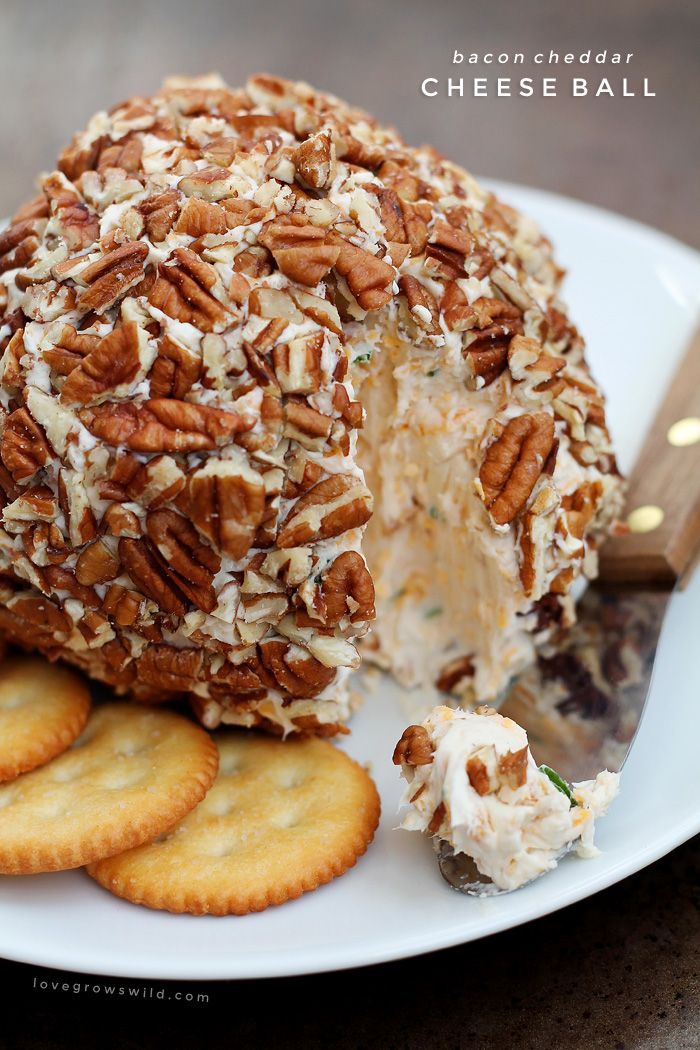 This Bacon Cheddar Cheese Ball is always a party favorite! Super creamy, loaded with bacon, and wrapped in pecans for a delicious and easy appetizer!