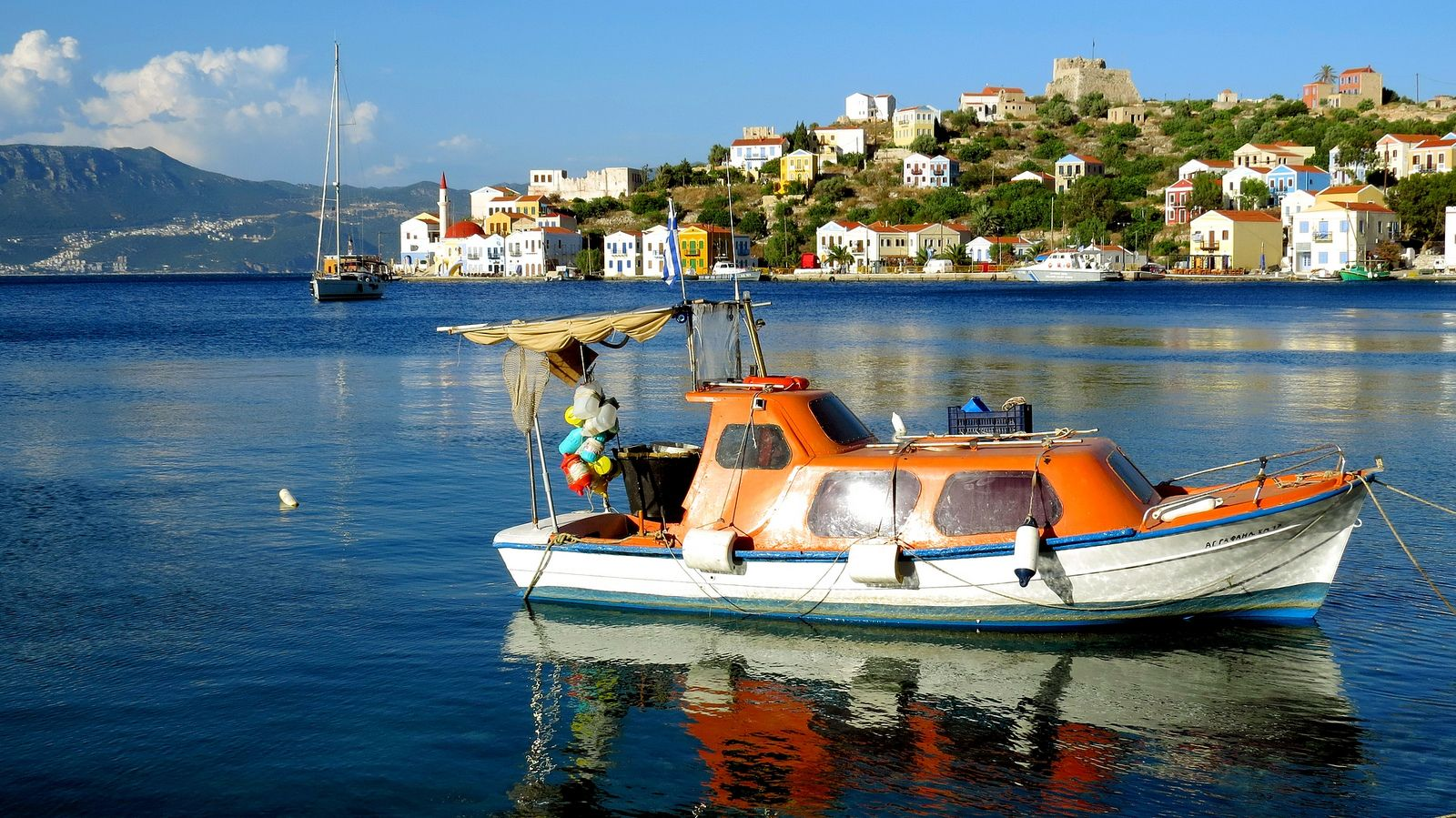 https://flic.kr/p/fkusr9 | Scenery with boat | Fishing boat reflected in the water and seashore. Kastelorizo island, Dodecanese, Greece