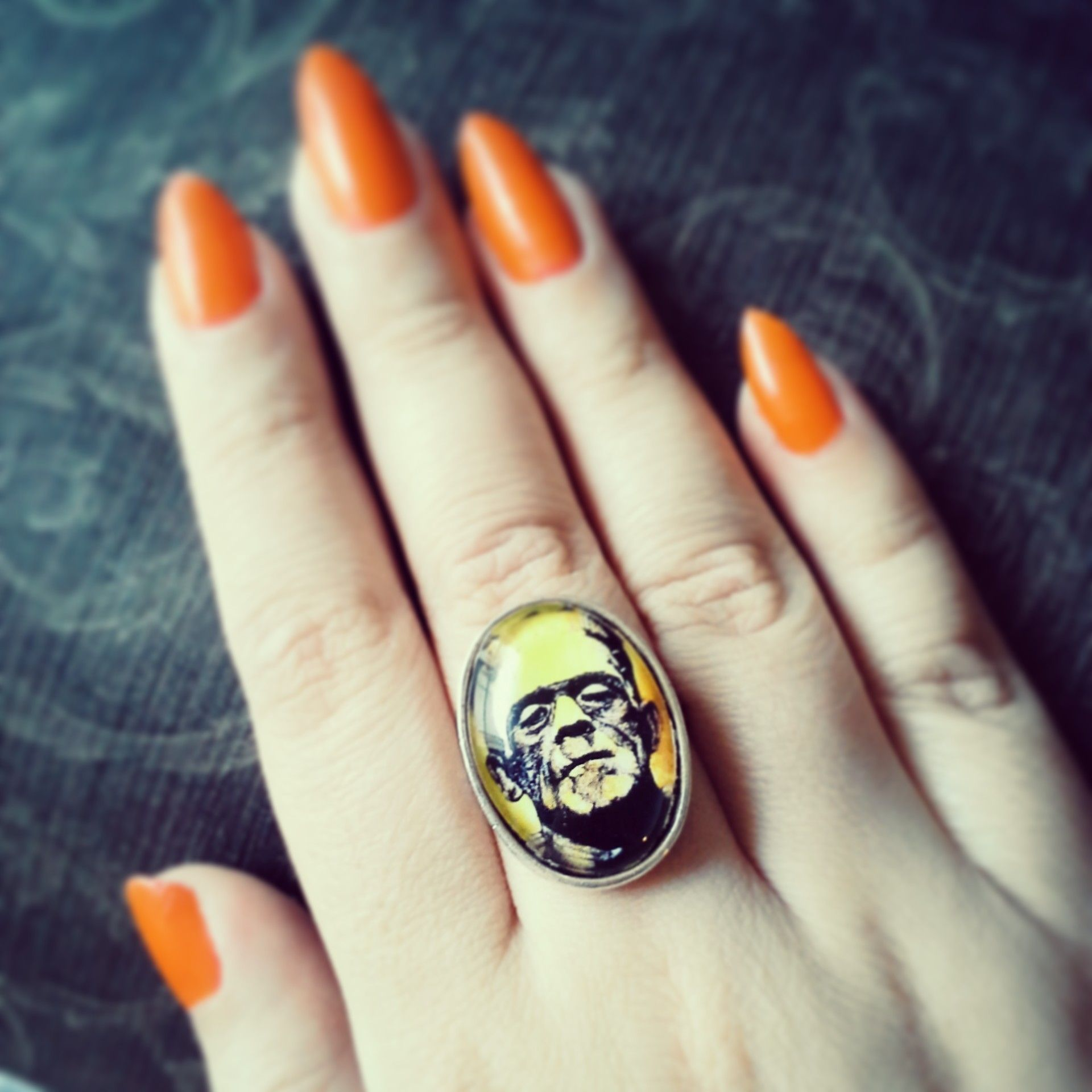 This ring features the artwork of Chuck Hodi. Ring is made with a 18x25mm glass cabochon and sits in a silver plated brass ring.  To view more of Chuck Hodi's art visit https://www.etsy.com/shop/chuckhodi  All images used with permission. ©Chuck Hodi
