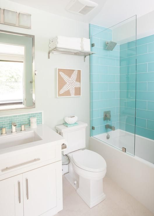 Beach Themed Bathroom Features A Drop In Shower Clad With Turquoise Glass Tiles Lined With A Beach Bathroom Decor Coastal Bathroom Design Beach House Bathroom