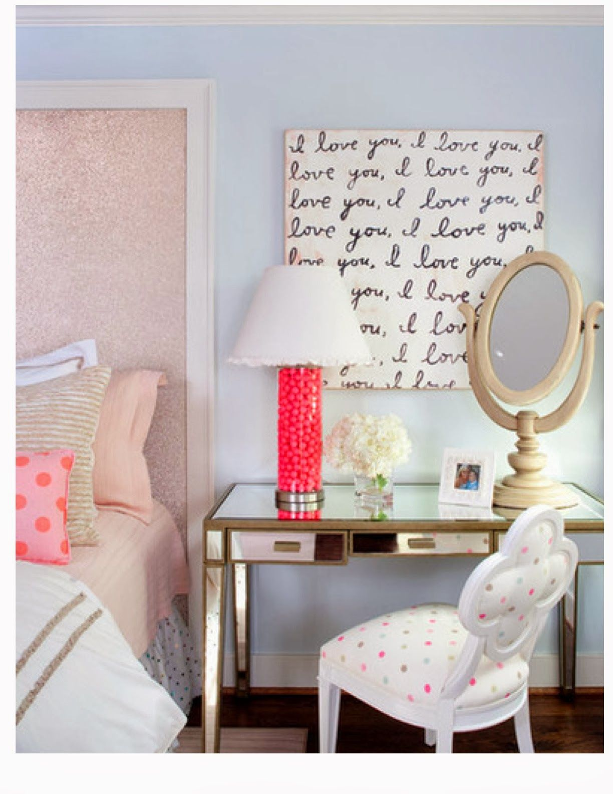 "mirrored desk/side table. ""I love you"" art. gold polka dot bedskirt & pink bedding."