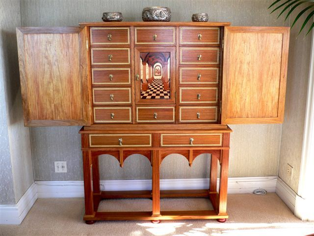 Detailed marquetry cabinet by Roy Howard