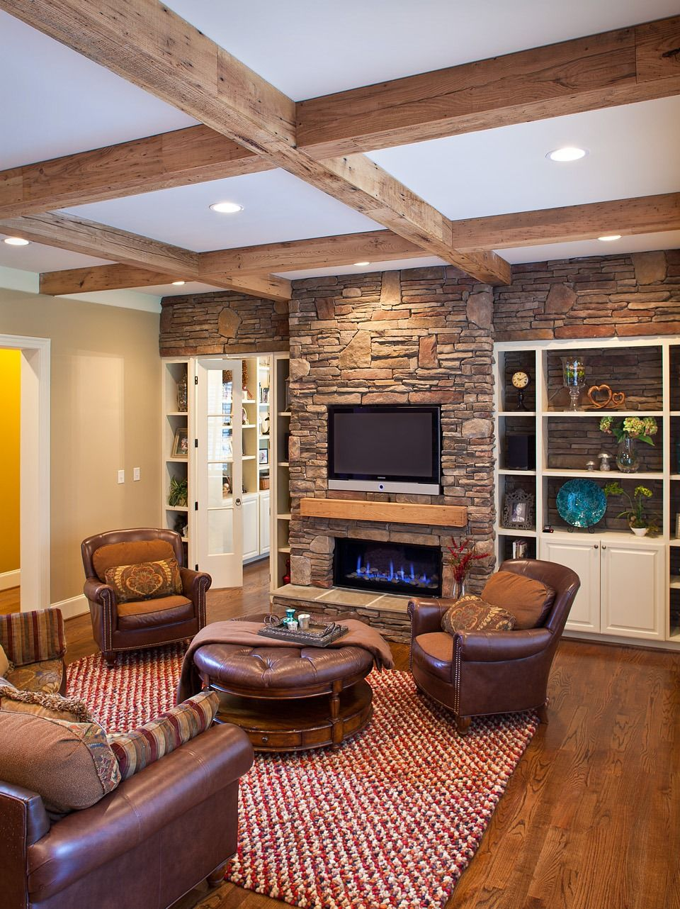 New fireplace with tv eclectic family room minneapolis - Family Room Expansion Included The Addition Of Antique Reclaimed Chestnut Beams And Mantel A Stone