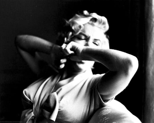 Marilyn Monroe photographed by Sam Shaw, 1954. ( I think this is a yawn...or the middle of a great sneeze )
