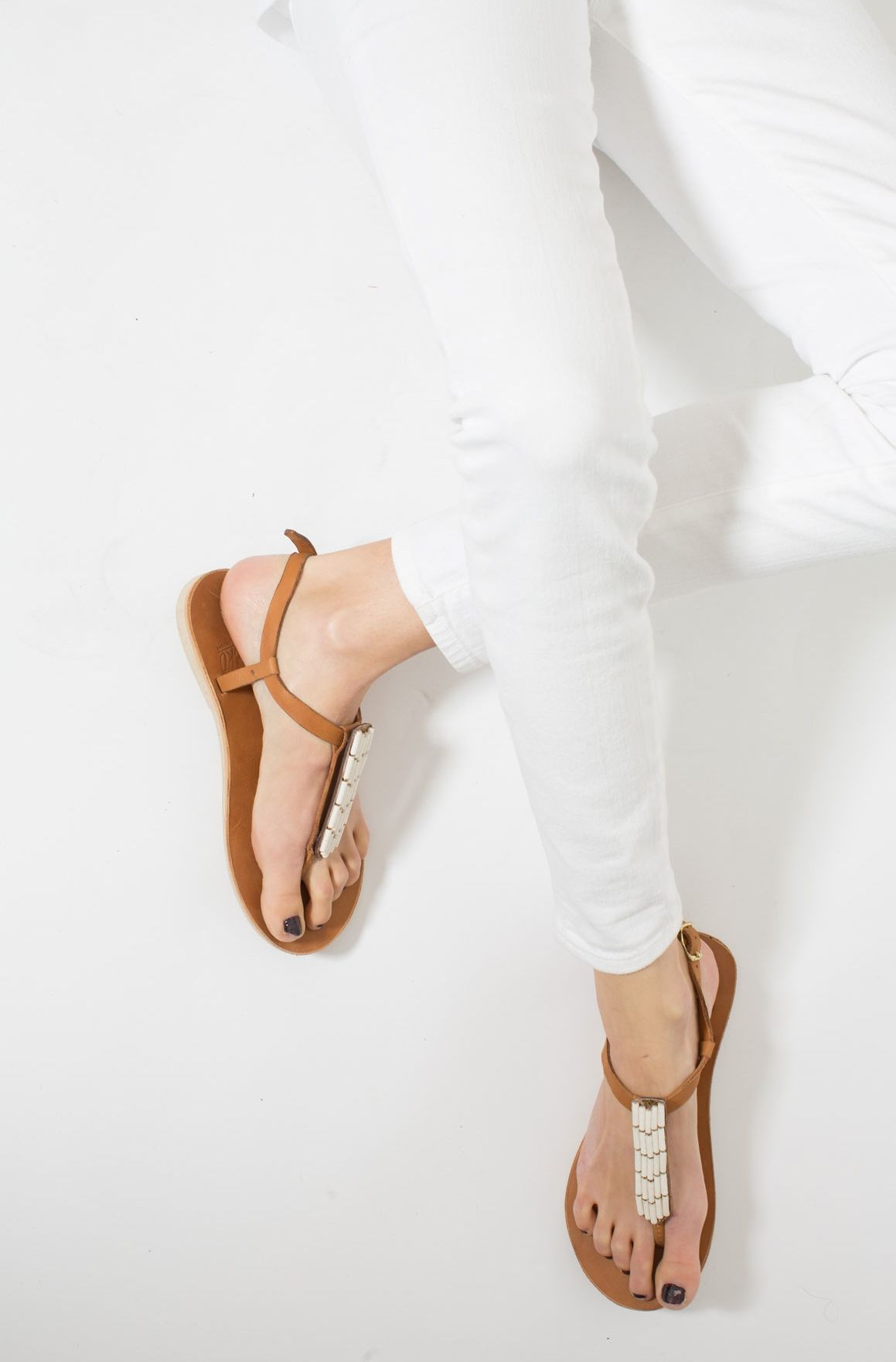 a9585569321d3 Caramel Leather T-Strap Sandals from Sseko Designs. Wear Sseko   Send a  Girl to College.