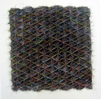 Polly Binns - Untitled 1982 black cotton with coloured thread, smocking technique. 50 x 45 x 5 cm