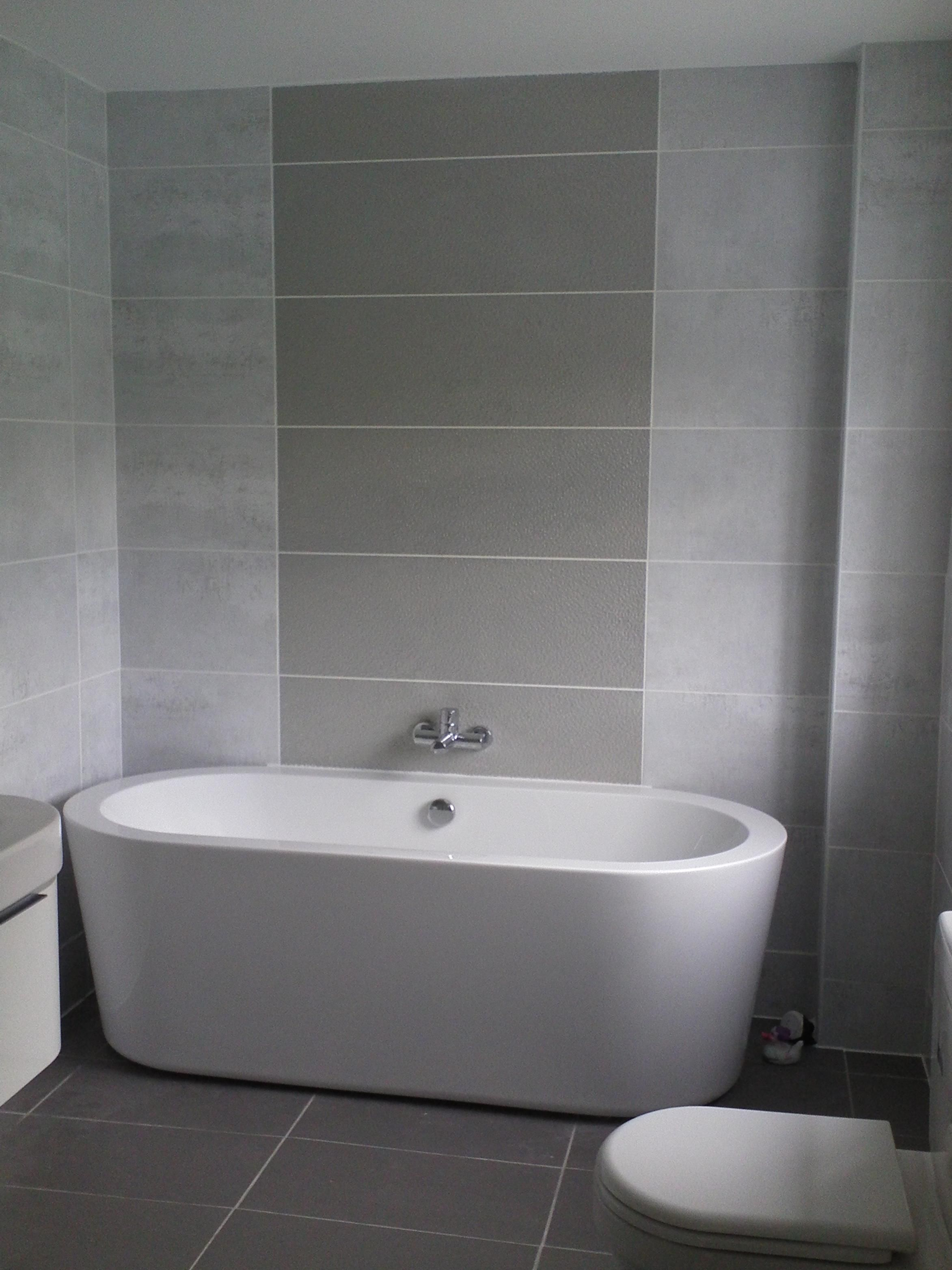 White Grey Tiles Bathroom Wall Added By Oval Bathtub And Toilet Bowl On Ceramics Flooring Breathtaking Ideas Of Shows