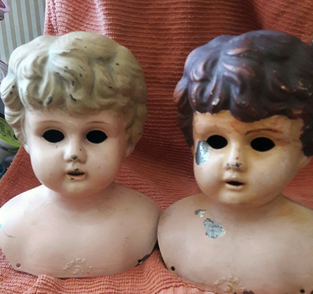 """Straight from grandma's attic! These two doll heads are marked """"Germany 8"""" and """"Minerva."""" Both are made of metal; one has an open mouth with teeth showing in a sweet smile. Non-smoking home.   eBay!"""
