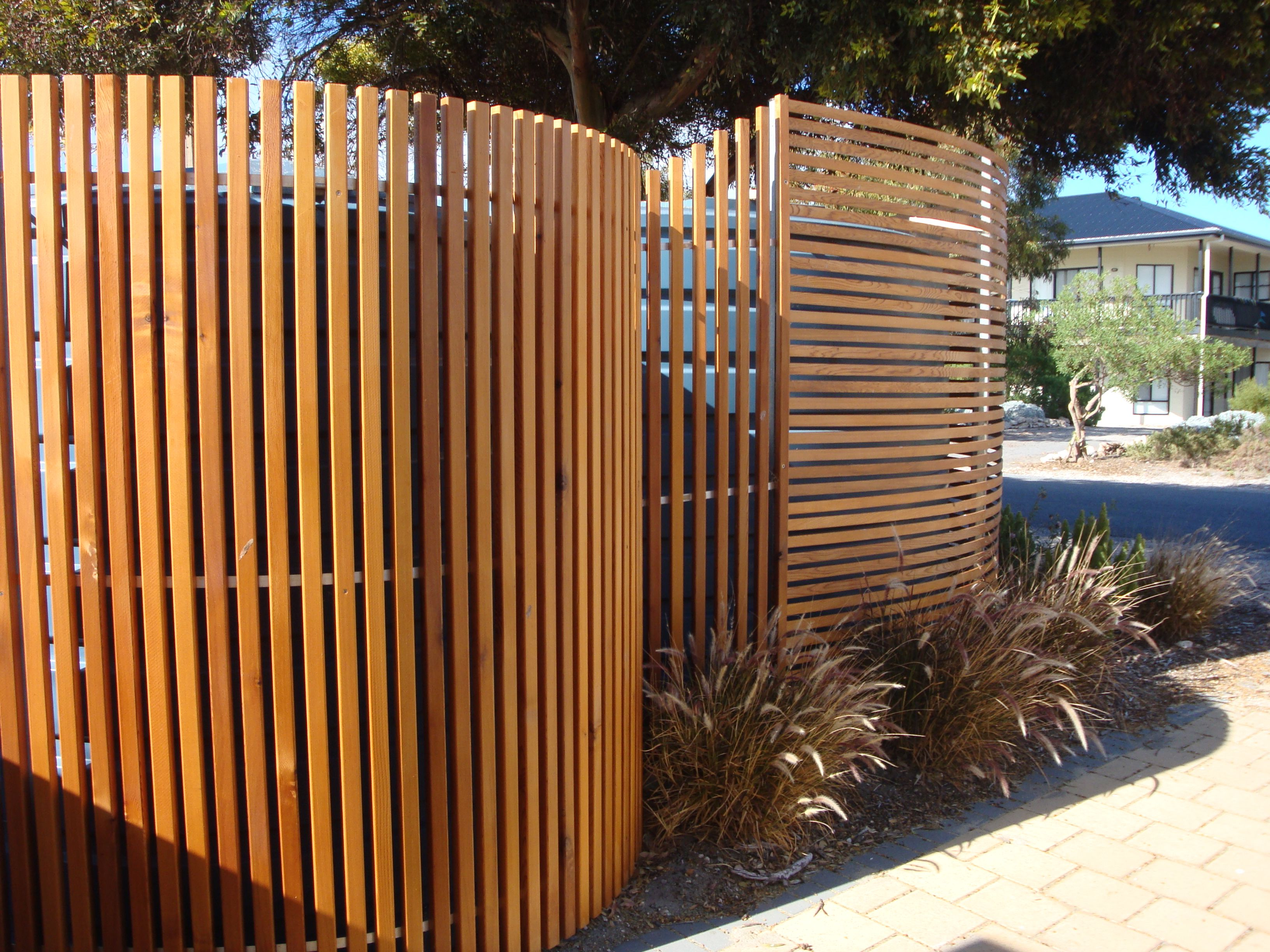 i built these cedar screens to hide the rainwater tanks