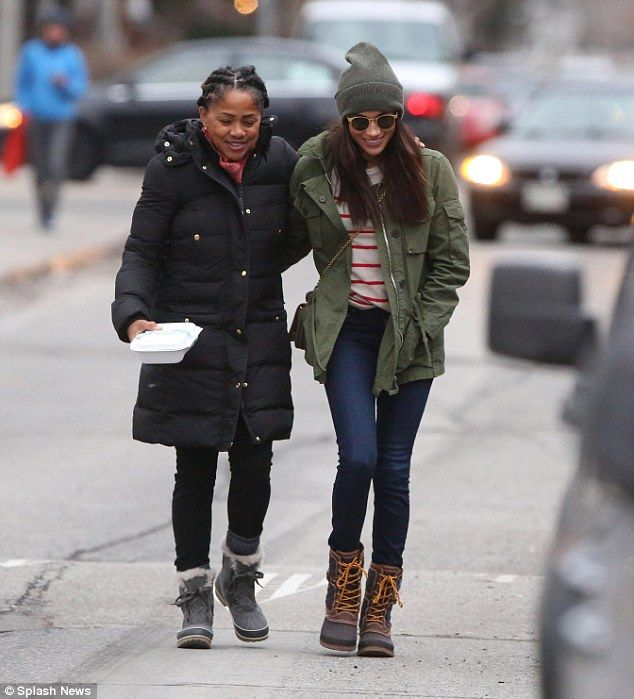 Family: Markle, pictured in Toronto with her mother Doria Radlan, left  Harry in