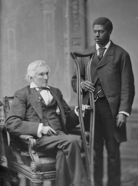 Alexander Hamilton Stephens, shown here in a striking post-war photograph with an African-American man holding his crutches, was vice president of the Confederate States of America.