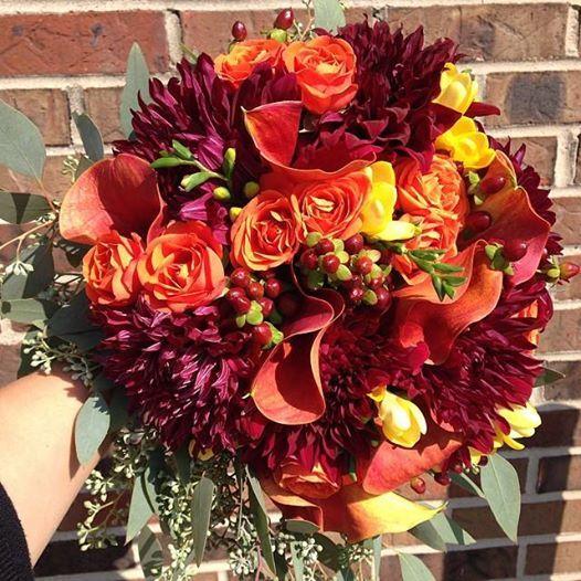 Zuzu's Petals Events: Fall inspired bouquet - Wine dahlias, mango callas, golden freesia, burnt orange roses, burgundy hypericum berries, and seeded eucalyptus.