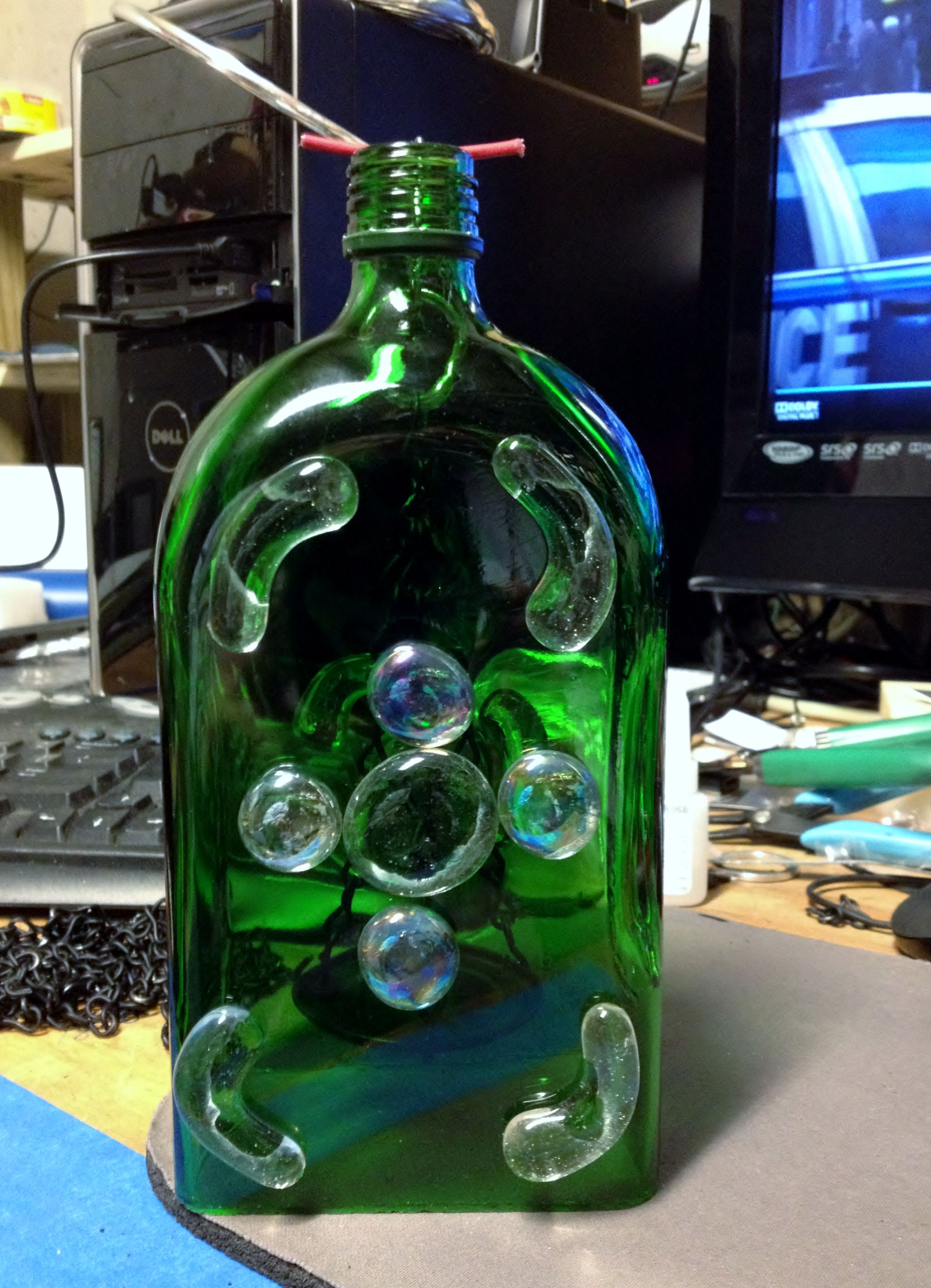 Green square bottle with glass design