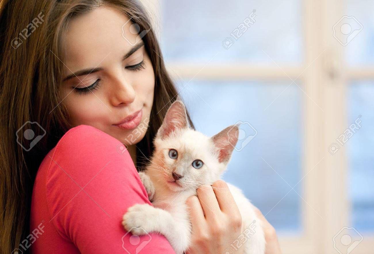 Portrait of a beautiful holding a cute kitten