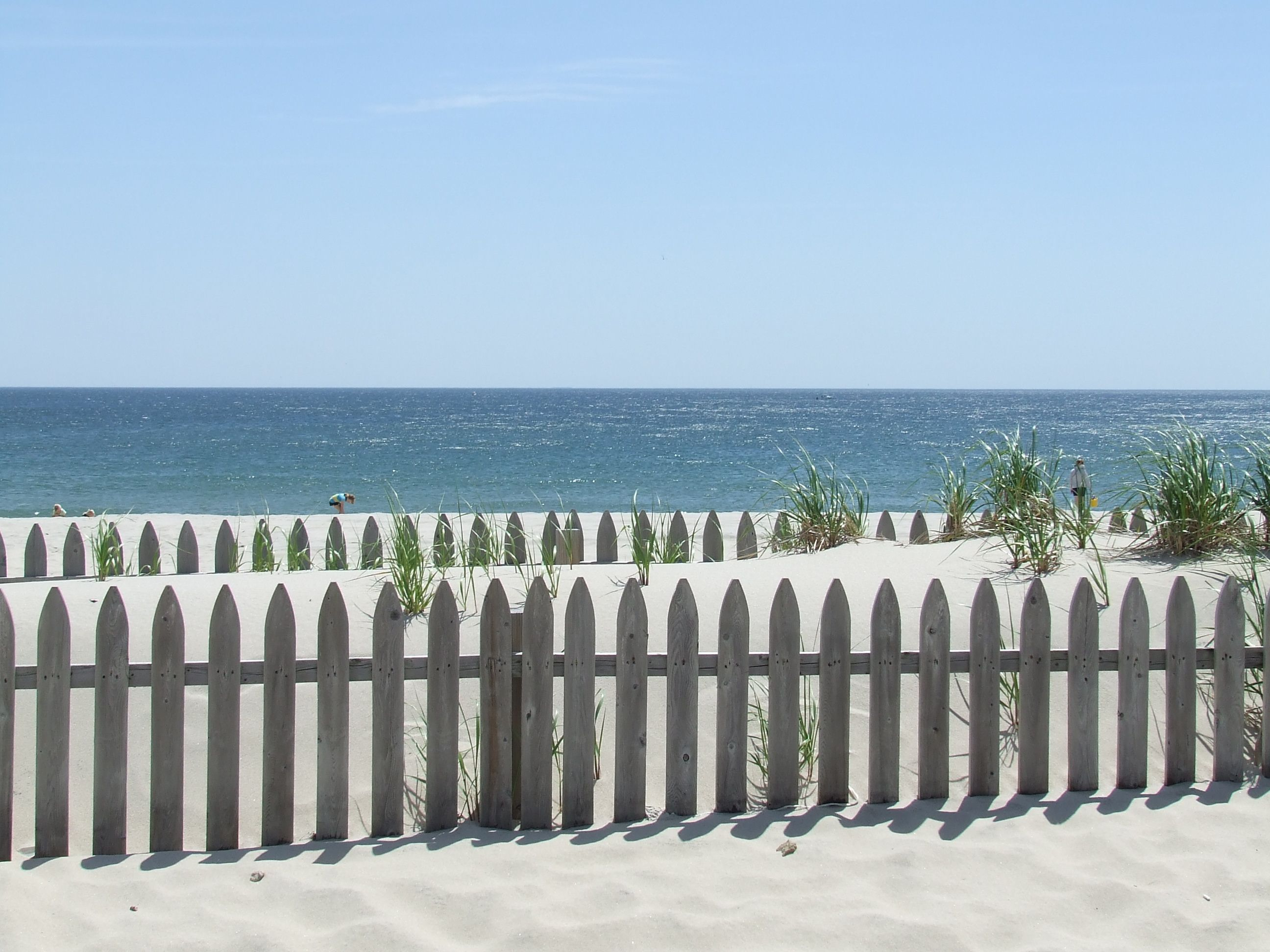 Looking over the sand dune fences at ocean beach new jersey shore looking over the sand dune fences at ocean beach new jersey shore nvjuhfo Choice Image