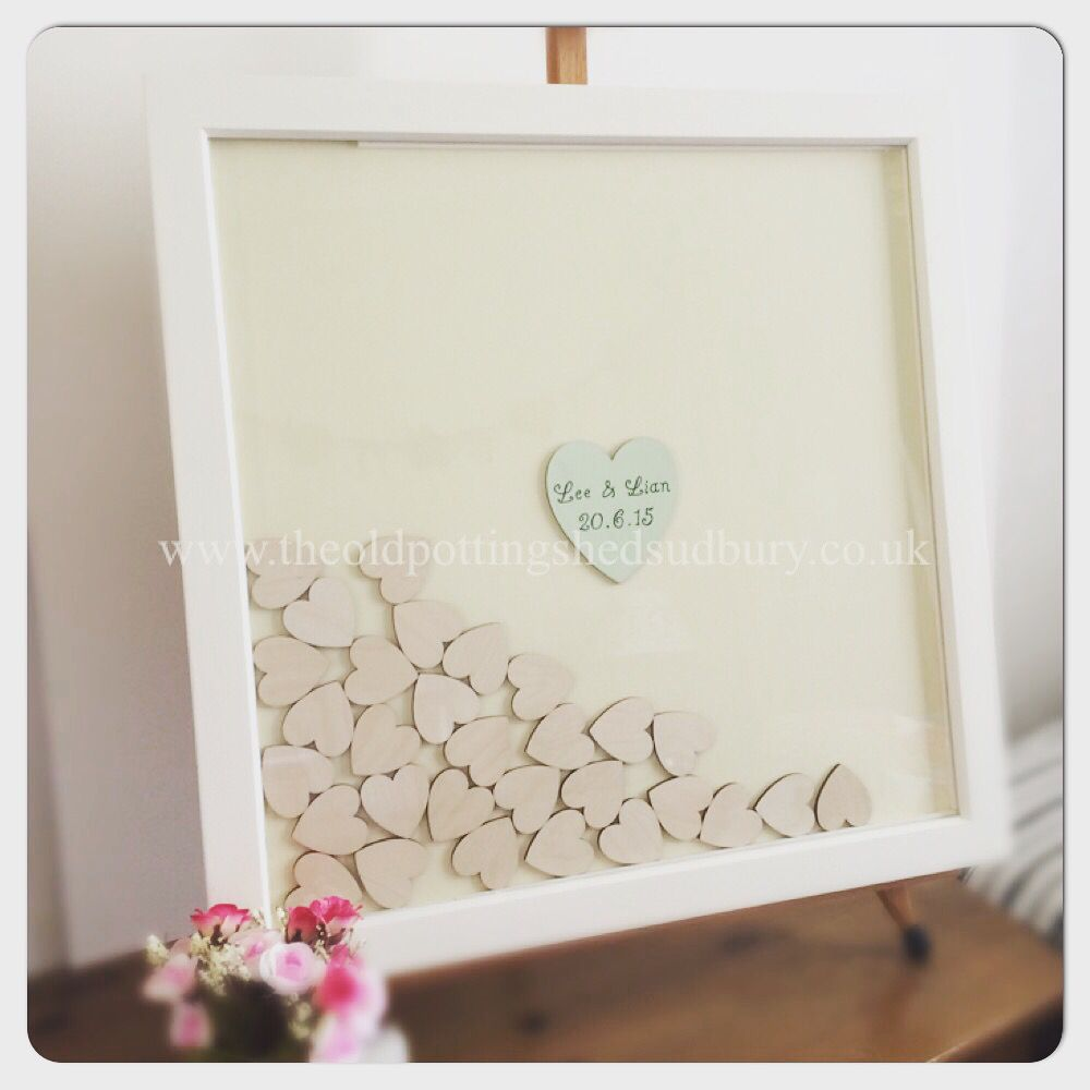 Drop top wedding guest book. White frame with an Ivory card back ...